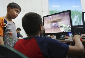 Palestinian children playing computer games