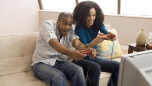 Man and woman playing video games together