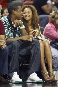 Beyonce and Jay-Z sitting together, holding hands, and enjoying one another's company