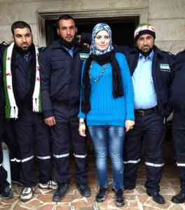 Razan Shalab Al-Sham with civil police in Khirbet al-Joz, Syria - NPR photo