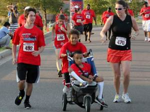 Titus and Tobias Bass running a 5k race in Oklahoma