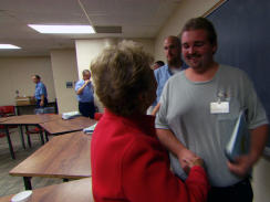 "SuEllen Fried greets inmates taking her ""Reaching Out from Within"" program"