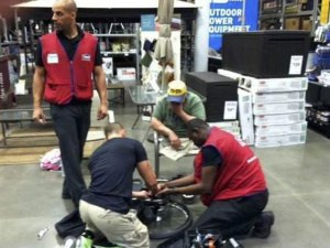 Lowe's employees David, Marcus, and Souleyman fix Michael Sulsona's wheelchair