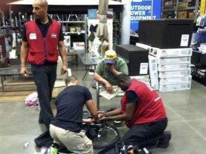 Lowe's employees David, Marcus, and Souleyman fix Michael Sulsona's wheelchair