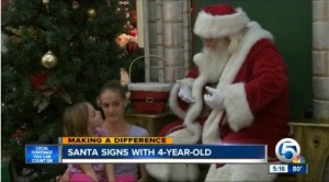 Santa signs for deaf 4 year old