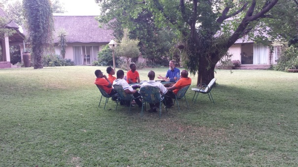 Lee Woofenden teaching a class attended by seminarians and a fellow faculty member